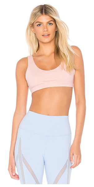 Alo Yoga Ambient Sports Bra in pink - Self: 87% nylon 13% spandexContrast: 92% poly 8%...