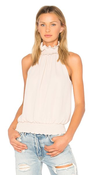 Amanda Uprichard Kimmie Mock Neck Top in beige - Poly blend. Dry clean only. Smocked elastic neckline and...