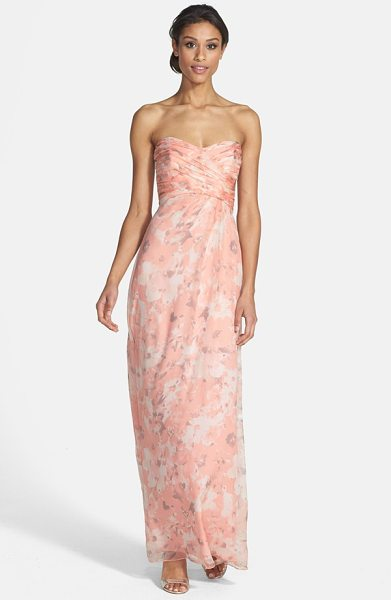 Amsale amore floral print silk chiffon gown in shell - Artful ruching crisscrosses the strapless,...