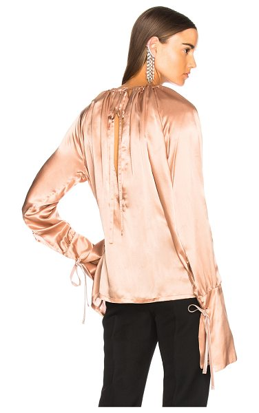 Ann Demeulemeester Blouse in pink - 100% silk.  Made in Macedonia.  Dry clean only. ...