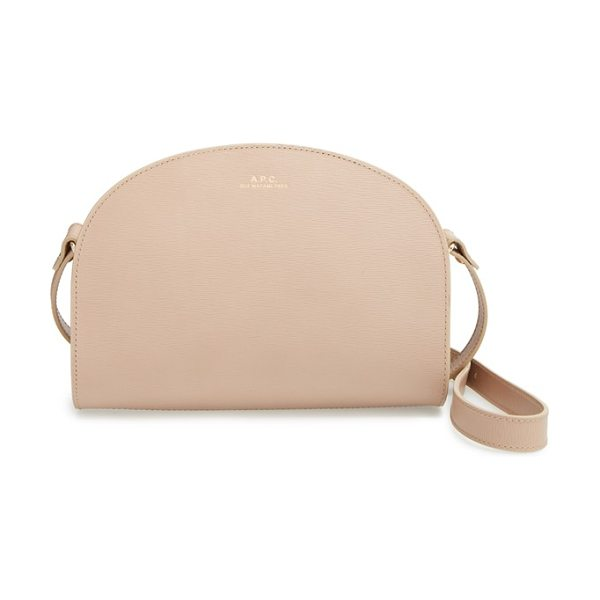 A.P.C. Demi lune embossed leather crossbody bag in beige fonce - Luxe Italian leather is stamped with a wavy motif,...