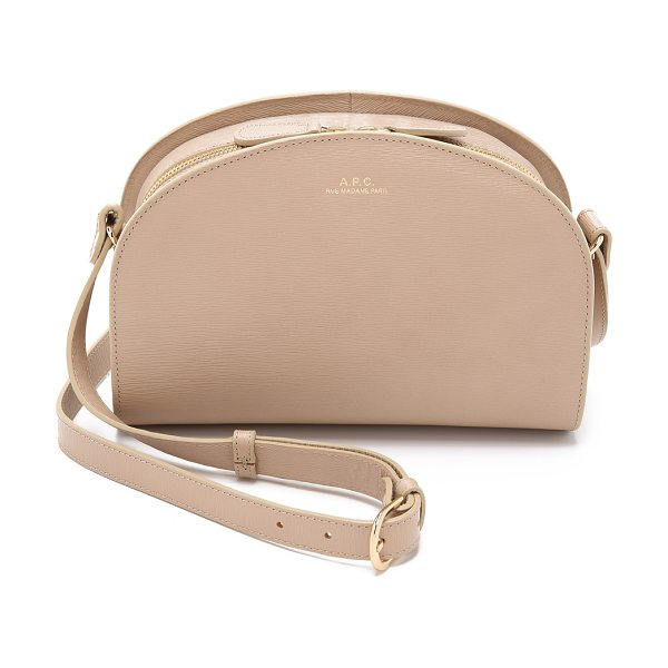 A.P.C. Half moon cross body bag in beige - A simple A.P.C. cross body bag, rendered in ridged...