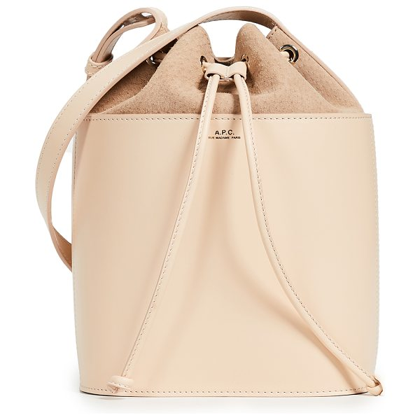 A.P.C. sac clara bucket bag in beige natural - Leather: Calfskin Suede trim Drawstring at top Zip...