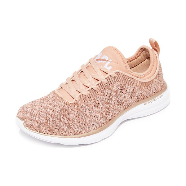 APL: Athletic Propulsion Labs techloom phantom sneakers in rose gold - Raised stitch patterns bring unique dimension to these...