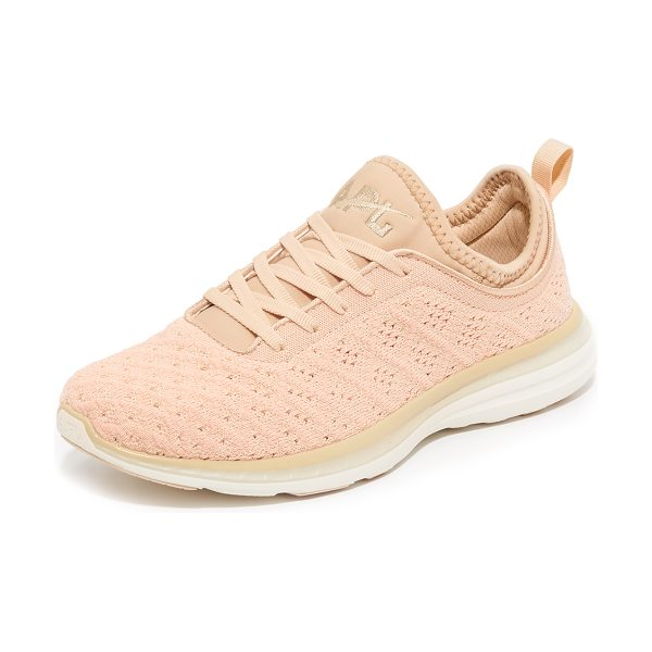 APL: Athletic Propulsion Labs Techloom phantom sneakers in blush/cream - Raised stitch patterns bring unique dimension to these...