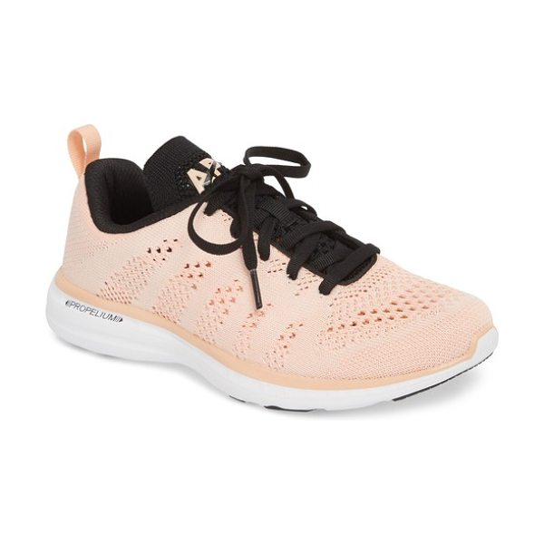 APL: Athletic Propulsion Labs 'techloom pro' running shoe in pink - This street-smart sneaker grounded with treads inspired...