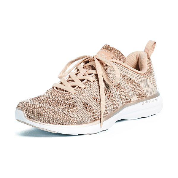 APL: Athletic Propulsion Labs techloom pro sneakers in rose gold/parchment - Mixed stitch patterns accent the fused knit upper of...