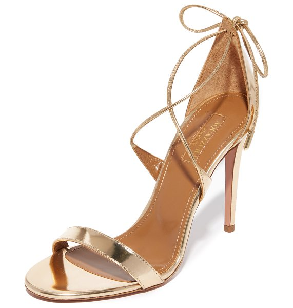 Aquazzura linda sandals in light gold - Slender straps crisscross and tie at the heel of these...