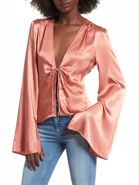 AFRM emma tie front top - A little retro, a lot racy, this fluid bell-sleeve...