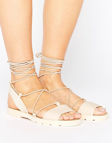Asos FLUTTER Tie Leg Jelly Sandals in beige - Sandals by ASOS Collection, Smooth rubber upper, Lace-up...