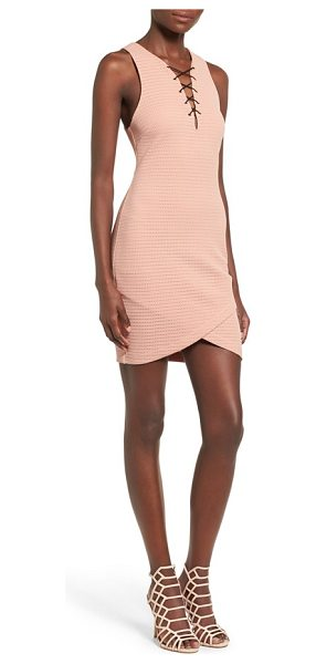 ASTR the Label lace-up body-con dress in blush - A flirtatious lace-up neckline and crossover tulip hem...