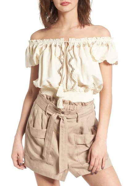 ASTR the Label astr reyna off the shoulder blouse in natural - Tassel-trimmed ties cinch the neckline of an airy blouse...