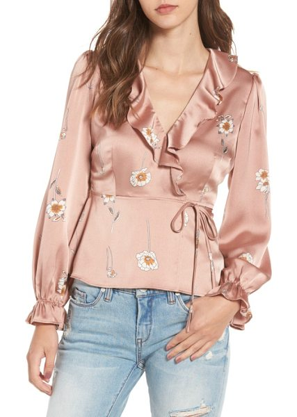 ASTR the Label chantilly wrap blouse in soft pink floral - Cinched at the waist to create a fluttery peplum hem,...