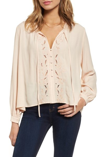 ASTR the Label madina blouse in blush - Embroidery and openwork detailing frame the button front...