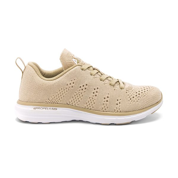 APL: Athletic Propulsion Labs Techloom Pro Sneaker in beige - Knit textile upper with rubber sole. Lace-up front....