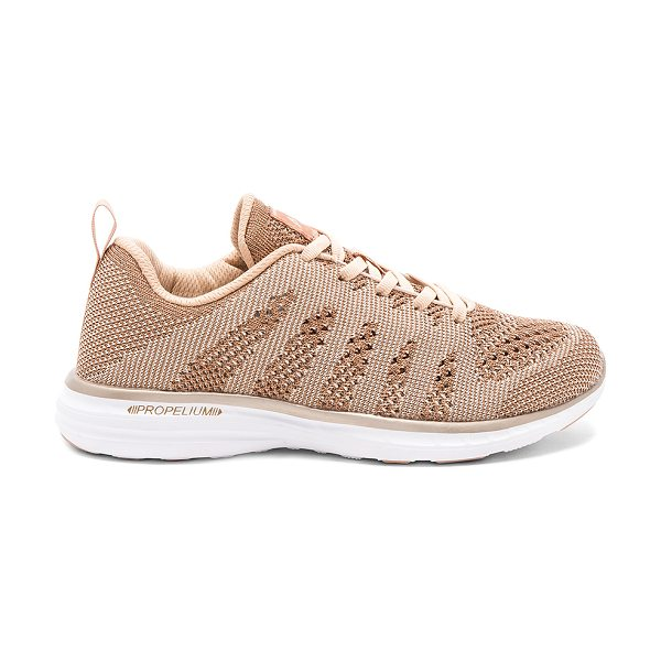 APL: Athletic Propulsion Labs TechLoom Pro Sneaker in metallic gold - Metallic textile upper with rubber sole. Lace-up front....