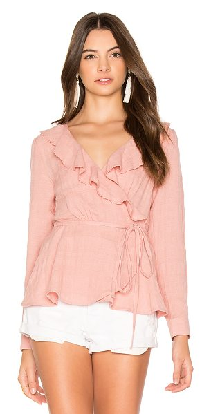 Auguste Harvey Wrap Top in pink - Cotton blend. Front tie closure. Ruffle trim. Buttoned...