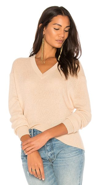 Autumn Cashmere Ribbed Hi Lo Sweater in beige - 100% cashmere. Dry clean only. Rib knit fabric....