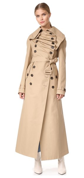 A.W.A.K.E. long trench coat in beige - A.W.A.K.E. reinterprets the classic trench coat with...