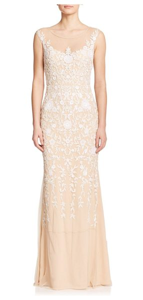 Badgley Mischka Beaded floral gown in champagne - An intricate beaded floral design envelops this lithe...