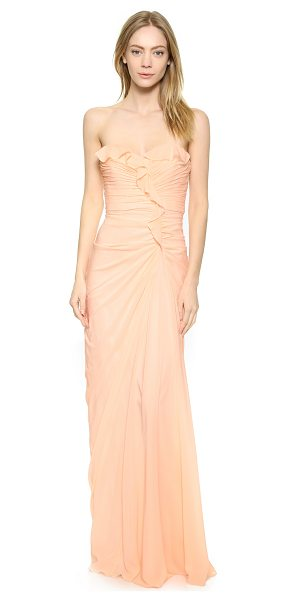 Badgley Mischka Collection Strapless ruffle gown in blush - A curved seam cuts a dramatic line on this Badgley...