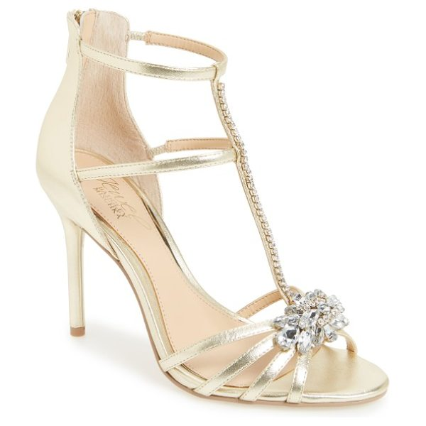 Badgley Mischka hazel embellished t-strap sandal in gold leather - Satiny toe straps converge with a burst of shimmery...
