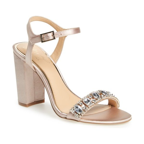 JEWEL BADGLEY MISCHKA hendricks embellished block heel sandal in champagne satin - Oversized crystals adorn the toe strap of an event-ready...