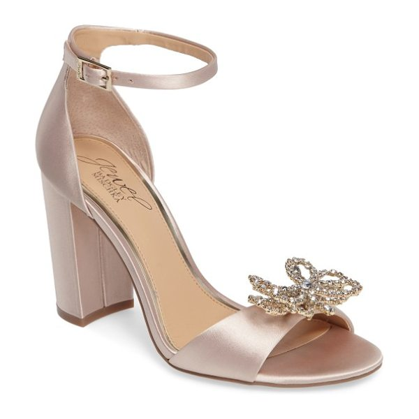 Badgley Mischka lex embellished block heel sandal in champagne satin - A bow-shaped brooch of layered crystals sparkles atop...