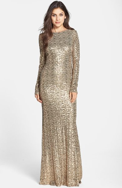 Badgley Mischka sequin drape back gown in gold - Gilt sequins bathe a stunning long-sleeve gown with a...