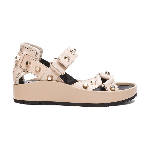 Balenciaga Studded leather ankle strap sandals in neutrals - Leather upper with rubber sole.  Made in Italy.  Approx...