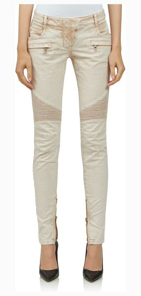 Balmain moto skinny jeans in beige - Moto-zip skinny cut with quilted panels. Belt loops. Zip...