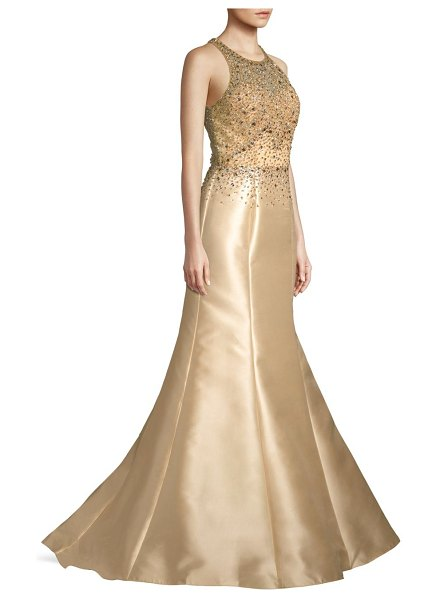 Basix Black Label beaded halter trumpet gown in champagne - Delicately beaded halter gown falls to a trumpet hem....