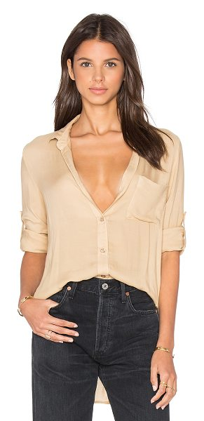 Bella Dahl Shirt Tail Button Down in cream - Rayon blend. Button front closures. Front breast pocket....