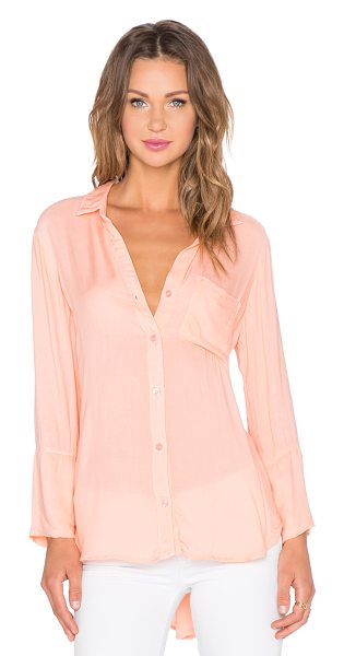Bella Dahl Shirt tail button up top in coral - 100% rayon. Front button closures. Front patch pocket....