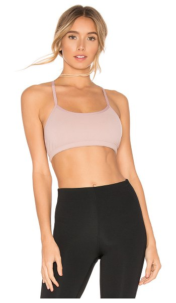 Beyond Yoga Cross It Back Bra in blush - Nylon blend. Adjustable shoulder straps. Criss-cross...