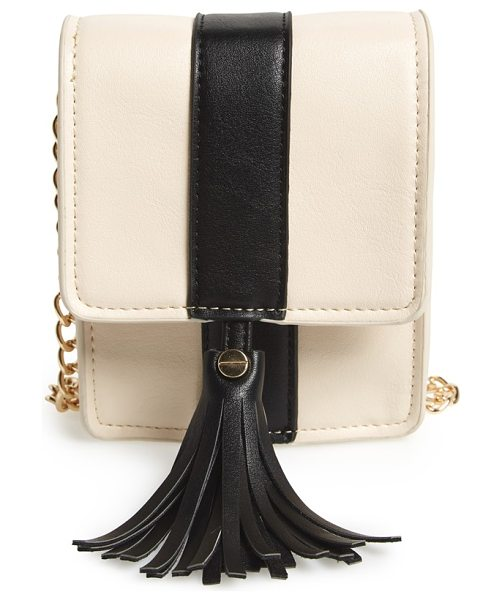 BIG BUDDHA Valery faux leather crossbody in bone/ black - Crisp color blocking, a swishy tassel and a chain-link...
