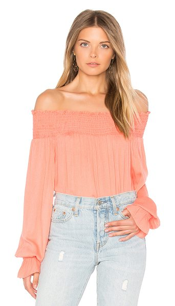 BLQ BASIQ Off Shoulder Long Sleeve Top in shell pink - 100% rayon. Dry clean only. Smocked elastic neckline and...