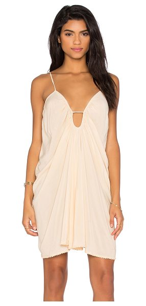 Blue Life Drape Criss Cross Back Dress in beige - 100% rayon. Dry clean only. Unlined. Crisscross back...