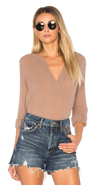 Bobi Gauze Long Sleeve Top in brown - 100% cotton. Button cuffed sleeves. Curved hem....