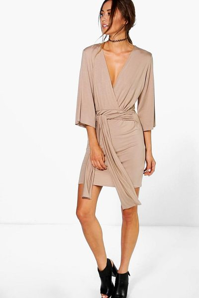 Boohoo Carmel Wrap Front Plunge Neck Dress in tan - Dresses are the most-wanted wardrobe item for...