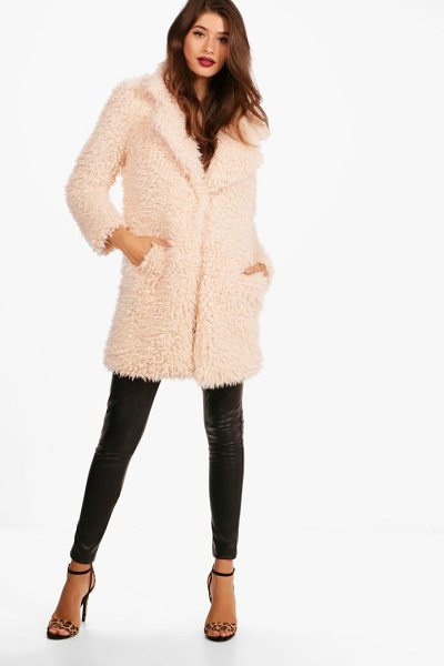 Boohoo Shaggy Faux Fur Coat in beige - Wrap up in the latest coats and jackets and get...
