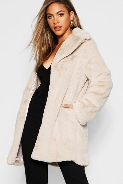 Boohoo Faux Fur Coat in beige - Wrap up in the latest coats and jackets and get...