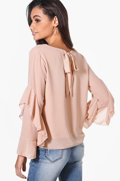 Boohoo Hollie Tie Back Ruffle Woven Top in nude - Steal the style top spot in a statement separate from...