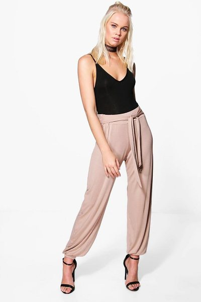 Boohoo Iman Tie Waist Jersey Hareem Trouser in sand - Kick back and relax in a pair of joggers. Whether you're...