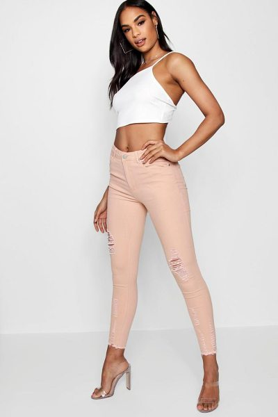 Boohoo Poppy High Waisted Destroyed Hem Skinny Jeans in nude - Jeans are the genius wear-with-anything wardrobe...