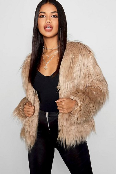 Boohoo Shaggy Faux Fur Coat in natural - Wrap up in the latest coats and jackets and get...
