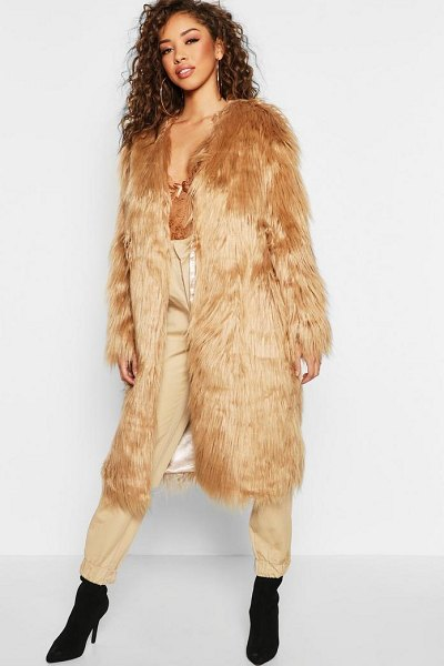 Boohoo Shaggy Faux Fur Coat in sand - Wrap up in the latest coats and jackets and get...