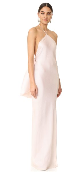Brandon Maxwell halter gown in petal - An optional, pleated silk overlay brings striking volume...