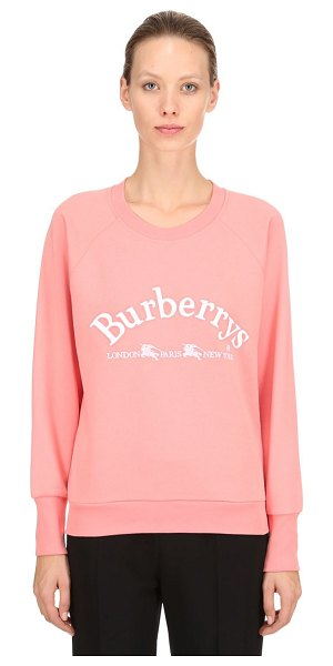 Burberry Logo printed cotton jersey sweatshirt in pink - Crewneck. Ribbed collar, cuffs and hem. Raglan sleeves....