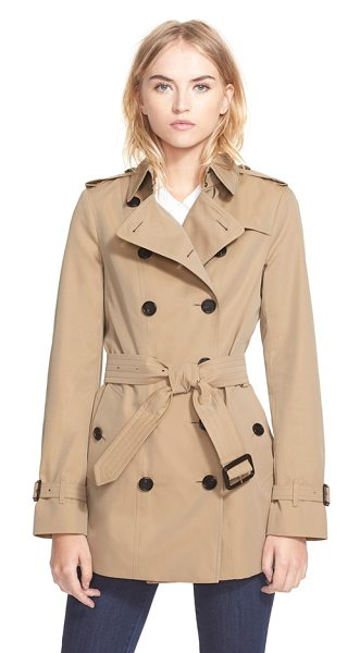 Burberry London sandringham short slim trench coat in honey - Rich buffalo-horn buttons pop against the golden...